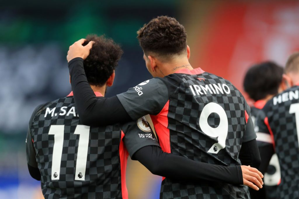 LONDON, ENGLAND - DECEMBER 19: Roberto Firminho of Liverpool celebrates with Mohamed Salah after scoring their sides fifth goal during the Premier League match between Crystal Palace and Liverpool at Selhurst Park on December 19, 2020 in London, England. The match will be played without fans, behind closed doors as a Covid-19 precaution. (Photo by Adam Davy - Pool/Getty Images)